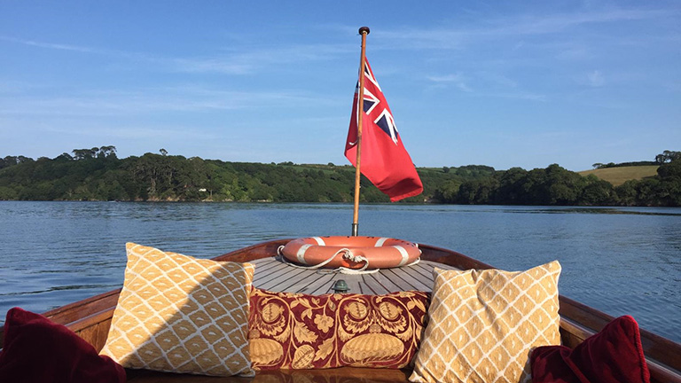 Step on board the majestic Constance for vintage luxury along the Helford River